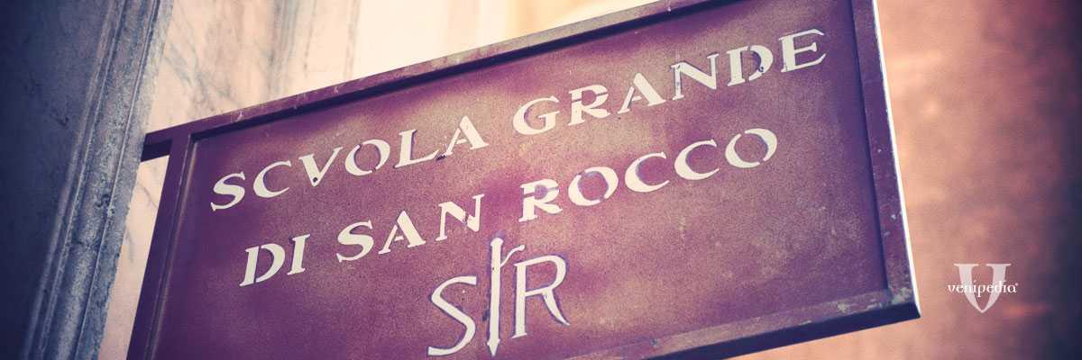 L'insegna della Scuola Grande di San Rocco.
