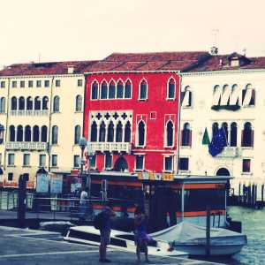 Some buildings overlooking the main waterway and partly covered by the vaporetto stop.