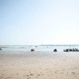 La spiaggia del bacàn e le barche dei veneziani durante una scampagnata.